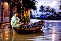 Woman on Boat in Flooded Street